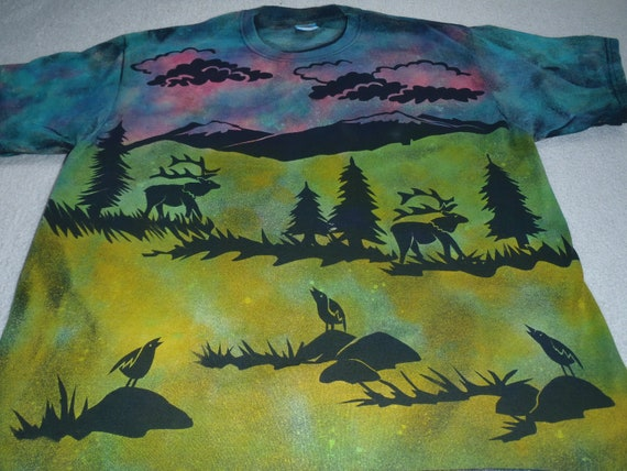 Man's XL discharge t-shirt,two elk with mountains in the background, thunder heads rolling in,birds sitting on rocks, colors are gorgeous