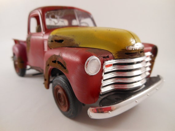 1950 Chevrolet 1/24 scale truck in  rust red and yellow with wood bumper