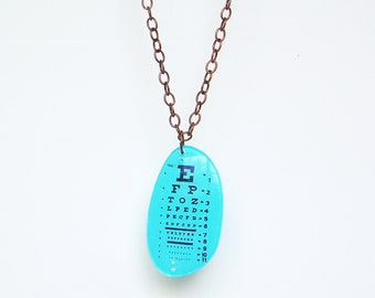 Neon blue eye chart pendant and chain made from prescription Rx lens