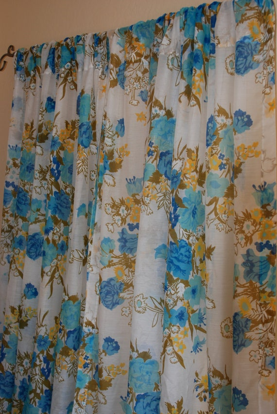 "Vintage sheer curtains with blue and yellow flowers, 2 panels, 60"" x 43""."