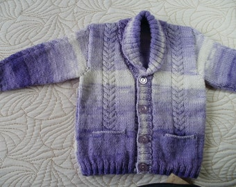 Hand knitted shawl neck cardigan / sweater with pockets and cable detail.  Age 1 - 2 years approx.