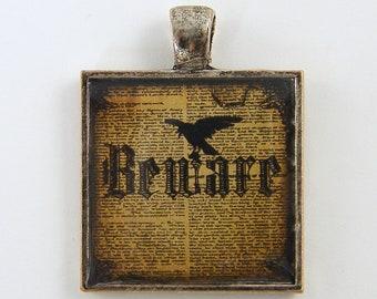 Beware Pendant - Black Bird Crow Raven Pendant Halloween Dictionary Page Black Tan Sepia Collage Silver Resin Jewelry