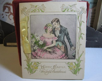 Gorgeous 1930's art deco easter card with victorian couple silk yellow ribbon and gold foil interior