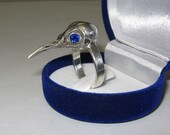 sterling silver bird skull ring with blue sapphires