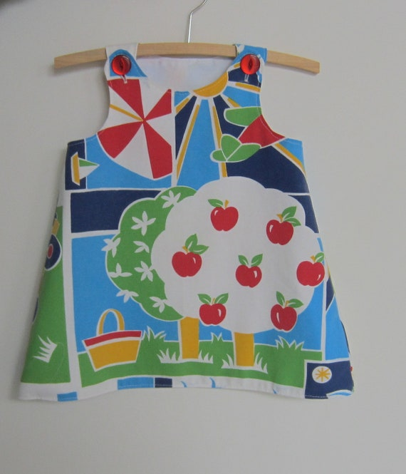 Upcycled baby dress size 1, 12 - 18 months, apple tree, eco friendly primary colours 80s style pillowcase, red buttons pinafore jumper pinny