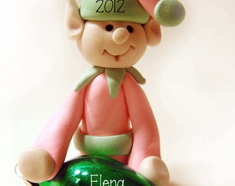 Polymer clay Christmas Ornament, pink elf, holding ornament, personalized, 2.5 inches, hand sculpted