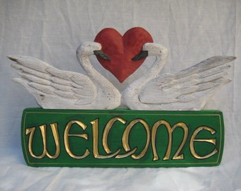Welcome Sign with 2 Swans