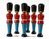 Set of 6 vintage bowling pins in the shape of british Soldiers