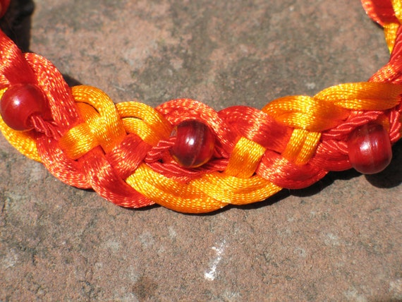 Extraordinary knotted, beaded bracelet in three colors by Nicole Wong