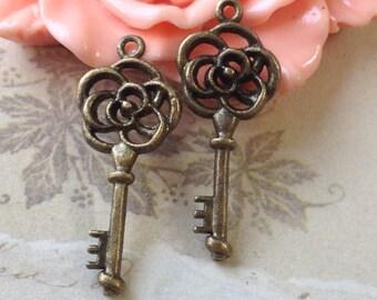 11 x 27 mm Little Flower Antique Bronze Key Charm Pendants (.ac)