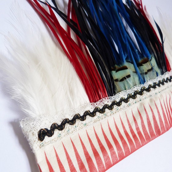 Feather headdress with red triangles and blue feathers