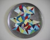 Abstract geometric painting on repurposed metal