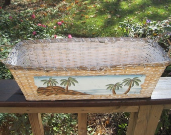 White wicker painted basket with palm trees
