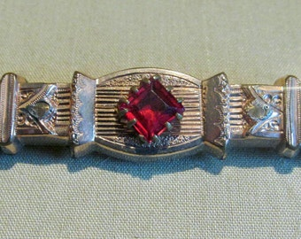 C. Late 1880's Victorian Gold Bar Pin with Red Stone