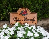 Beautiful family signs, made to order.  Made of Hardwood and look great.