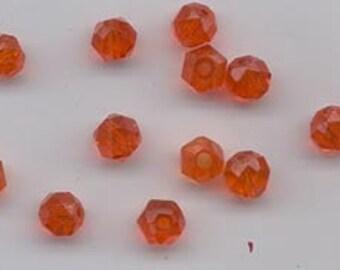 100 vintage Japanese machine-cut glass beads - slightly reddish orange - 6.5 mm