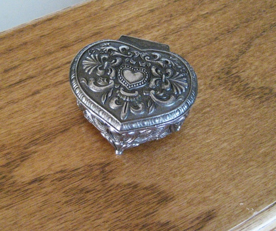 Vintage casket style silver jewelry box.  Heart with wings. Japan.