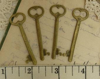 4 aged brass / bronze simple skelton keys  pendant / charm  size 51 mm x 15 mm