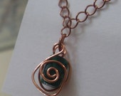 Spiral Caged Emerald Pendant