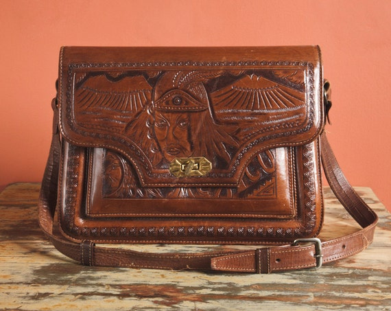 INSANE vintage 70s tooled leather Bag//Tribal Aztec impressions//Face//Huge//Ajustable Strap//Navajo//India