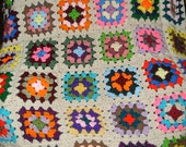 Crocheted  Granny Square Afghan  (off whtie border) approx 44x60