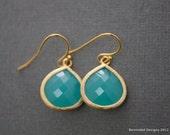 492- Gold framed aqua color stone earrings
