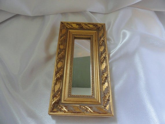 Metallic gold burnished wood  small mirror beaded trim and acanthus leaf design