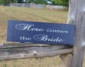 Here comes the bride/happily ever after wedding sign. Bridal party.