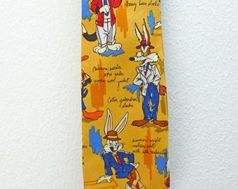 Men's Silk Tie by Warner Brothers with Looney Tunes Characters Wearing their Finest.