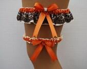 Wedding Garter Set - Ivory with Orange Spice Ribbon, Dark Brown Lace Overlay and a Swarovski Crystal Charm