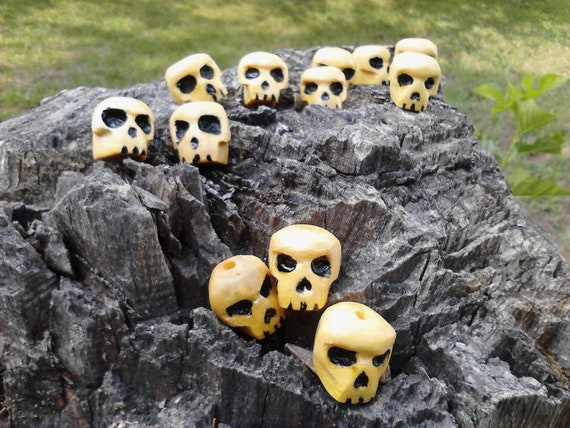 A Dozen Handcarved Wooden Skull Beads  (12ct)