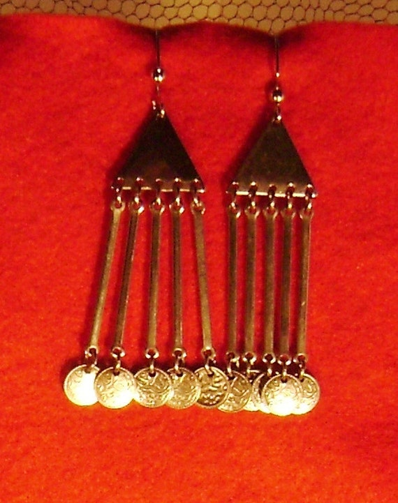 Tiny little silver coins dangle at the end of these bellydance looking earrings.
