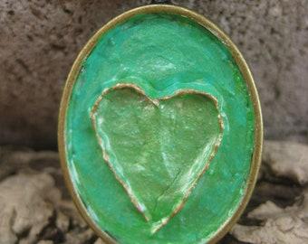 Bronze 3D Heart with Aqua Green Background