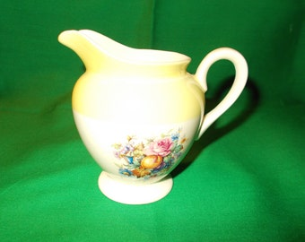 One (1) 6-8oz Creamer from Steubenville China