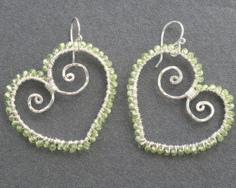 Luxe Bijoux 126 Hammered hearts wrapped with peridot Luxe Bijoux 126
