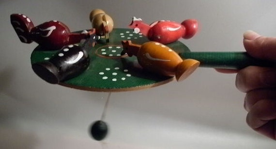 A Vintage Handcrafted Chicken Paddle Toy - Folk Art from Poland