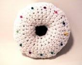 Crochet pincushion chocolate donut with white icing sprinkles