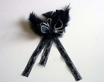 Black feather and lace hair bow