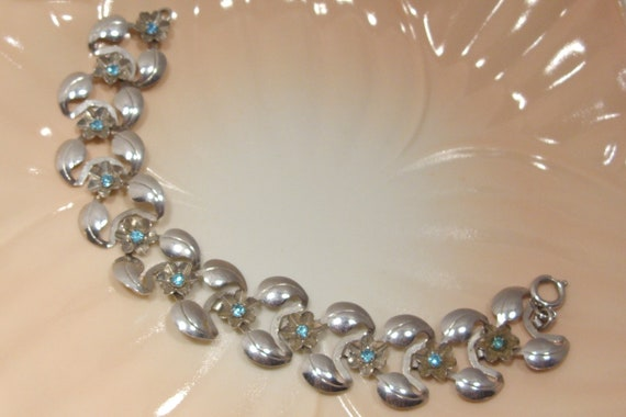 Silver Link Bracelet With Blue Rhinestone Flowers