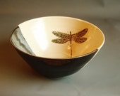 Handthrown ceramic bowl with handpainted dragonfly. Black glaze