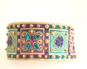 Couture dog collar.Egyptian style embroidered cloth with faux gems and sequins.