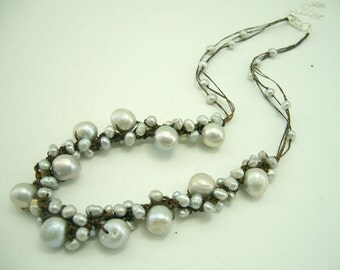 Light grey freshwater pearl hand knotted wax cotton necklace.