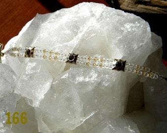 Casted swarovski spacers in gold with double strand of swarovski crystals Bracelet