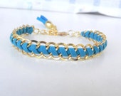 Gold double chain, blue faux suede cord