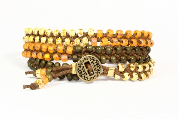 Wrap bracelet.  Braided bracelet.  Moss army green, apricot, cream TOHO seed beads.  Antique gold button.  Hippie.