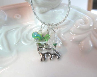 Necklace wolf charm necklace lampwork bead and glass flower