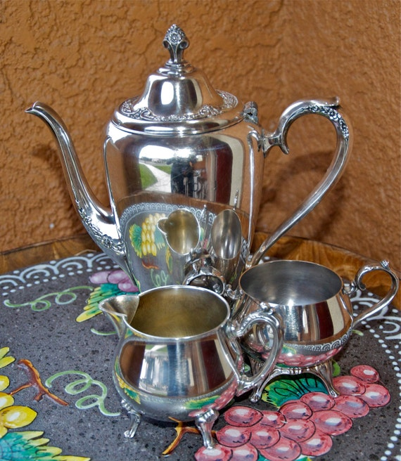 Vintage silver-plated coffee or tea serving set with carafe, cream and sugar (w/ lid) servers.