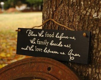 bless the food before us, the family beside us, and the love between us. Amen wood sign