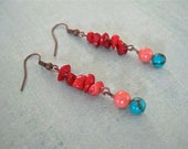 colorful. antiqued copper earrings. turquoise green beads. peachy swarovski glass pearls. red coral chips. unique. red teal coral.