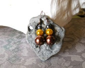 antiqued copper earrings. yellow. bronze. titanium gray. glass pearls. color block.